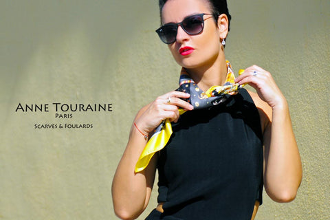 Astrology zodiac inspired silk scarf by ANNE TOURAINE Paris™; yellow color; tied around the neck; perfect with a black top!