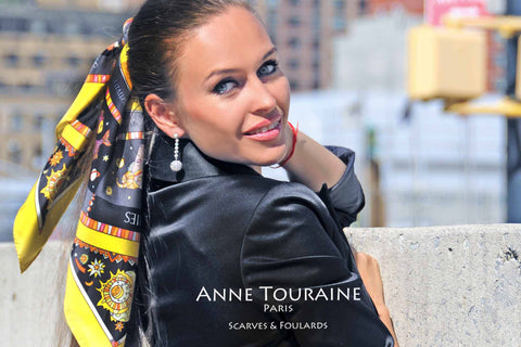 Astrology zodiac inspired silk scarf by ANNE TOURAINE Paris™; yellow color; tied around a ponytail; perfect with a black top!