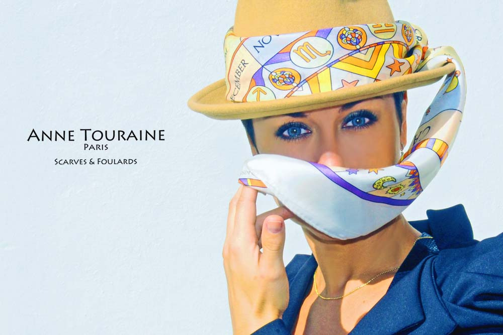 French silk scarves by ANNE TOURAINE Paris™: Zodiac astrology white scarf around a felter hat