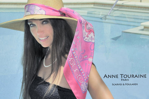 Fuschia silk scarf by ANNE TOURAINE Paris™ around a straw hat: a summer must-have