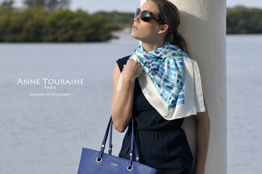 Extra large silk scarves by ANNE TOURAINE Paris™: blue and white silk satin scarf tied as a shoulder wrap and tilted to the side