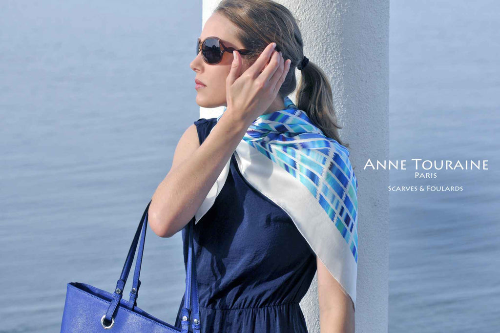 Extra large silk scarves by ANNE TOURAINE Paris™: blue and white silk satin scarf tied as a half shoulder wrap