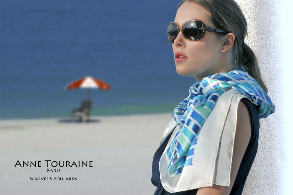 Extra large silk scarves by ANNE TOURAINE Paris™: blue and white silk satin scarf tied as a loose shoulder wrap