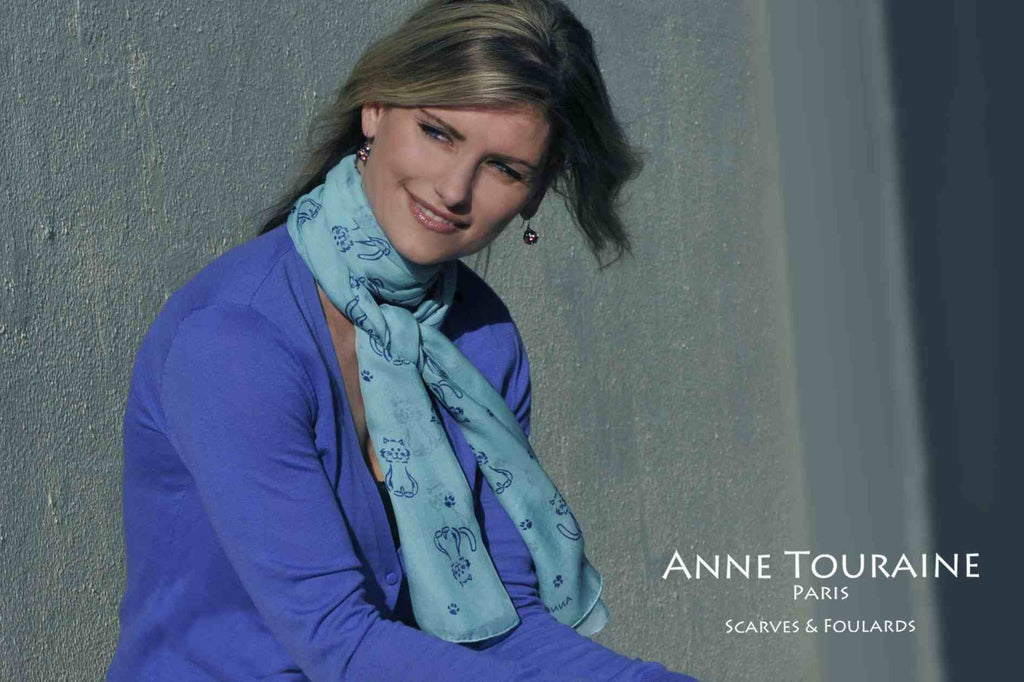 Chiffon silk scarves by ANNE TOURAINE Paris™: blue cat pattern scarf wrapped twice around the neck and tied to the front