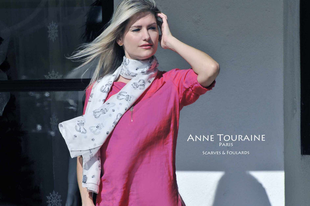 Chiffon silk scarves by ANNE TOURAINE Paris™: light grey cat pattern scarf wrapped twice around the neck and hanging loose to the front