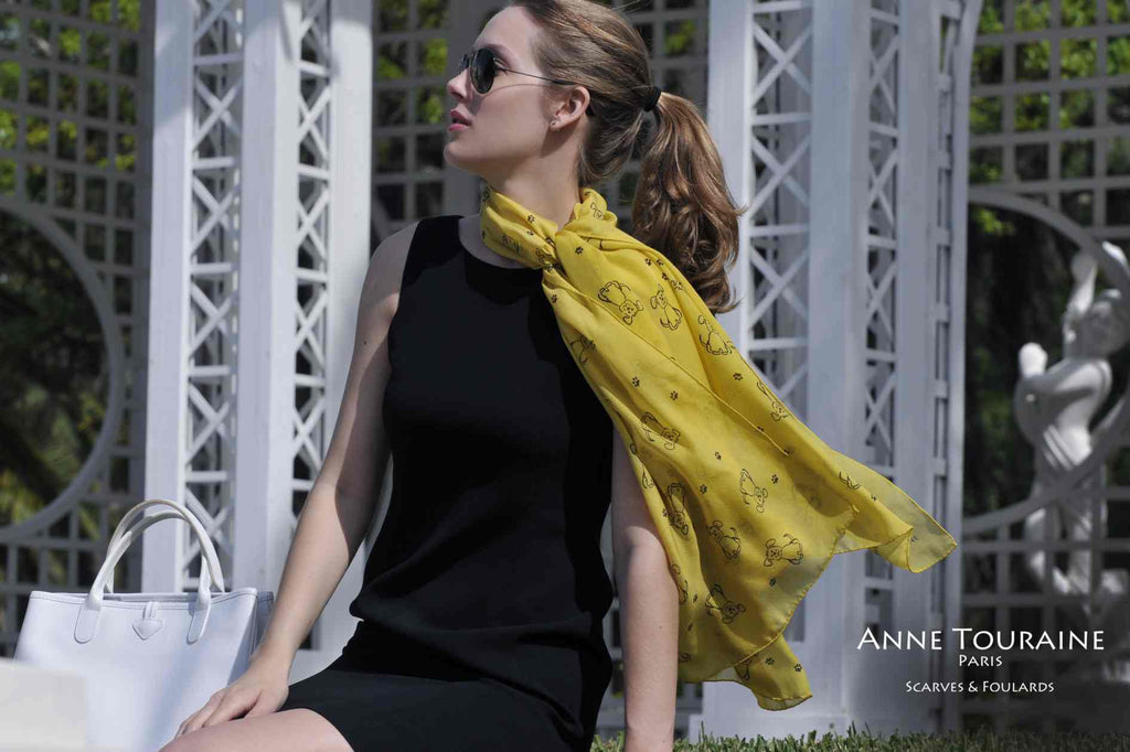 Chiffon silk scarves by ANNE TOURAINE Paris™: yellow dog pattern tied at the side of the neck