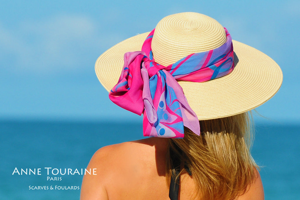 Extra large silk chiffon scarves by ANNE TOURAINE Paris™: pink and blue wrapped and tied with a fluffy knot around a hat