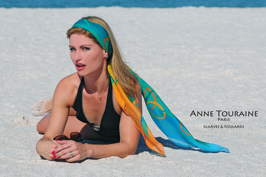 Extra large silk chiffon scarves by ANNE TOURAINE Paris™: teal and orange scarf tied in the hair as a long headband
