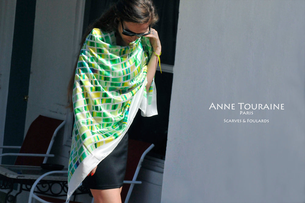 Extra large silk scarves by ANNE TOURAINE Paris™: green and yellow silk satin scarf tied as a large shoulder wrap