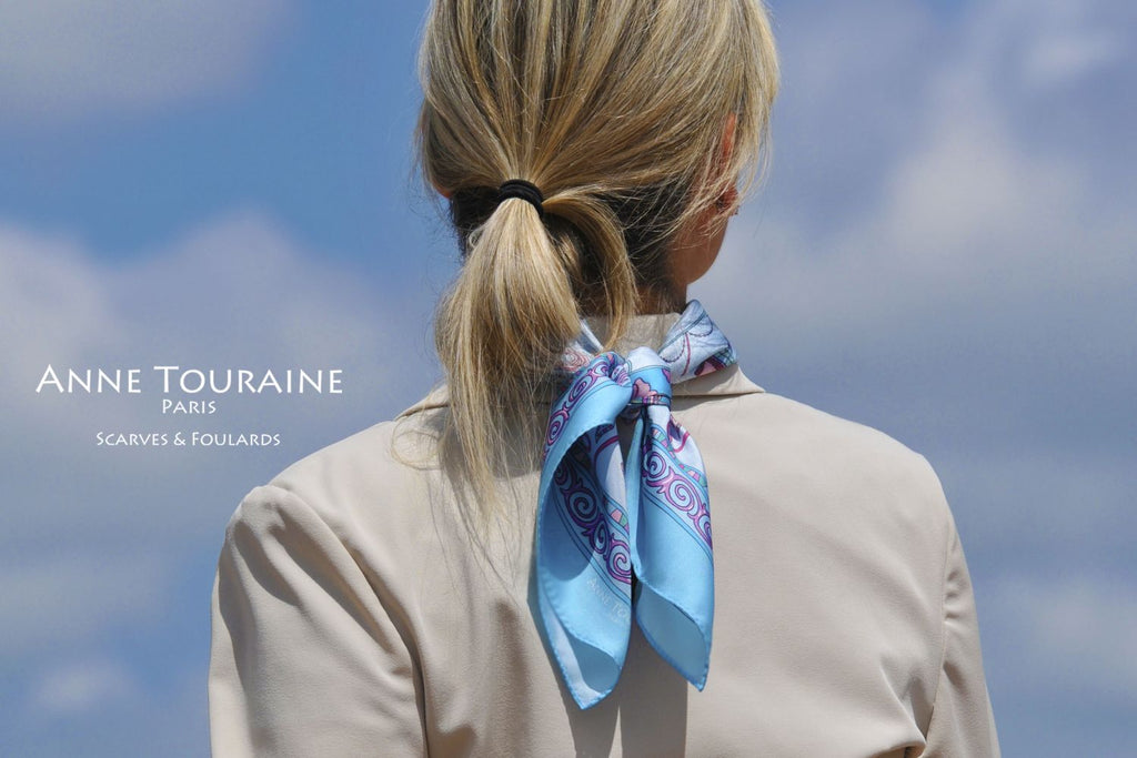 French silk scarves by ANNE TOURAINE Paris™: China inspired neon blue scarf tied at the back of the neck