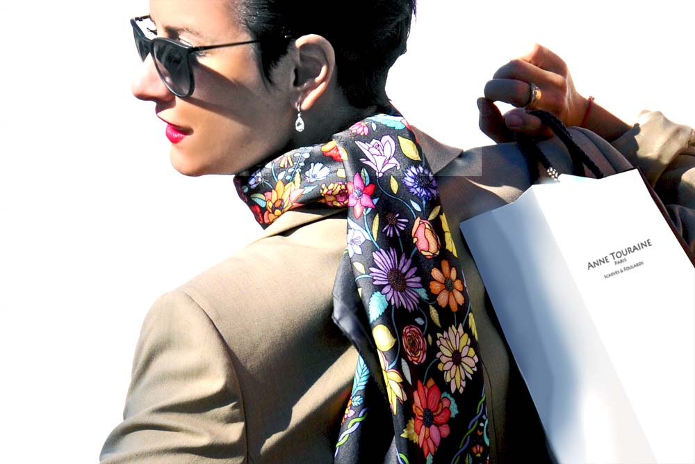 French silk scarves by ANNE TOURAINE Paris™: Floral grey scarf tied at the back of the neck