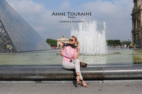 Elegant and stylish French woman wearing the ANNE TOURAINE Paris™ astrology black silk scarf