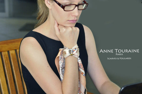 French scarves: silk twill, peach color: a French scarf created by ANNE TOURAINE Paris™; tied with a scarf ring and wrapped around the wrist to create an original bracelet.