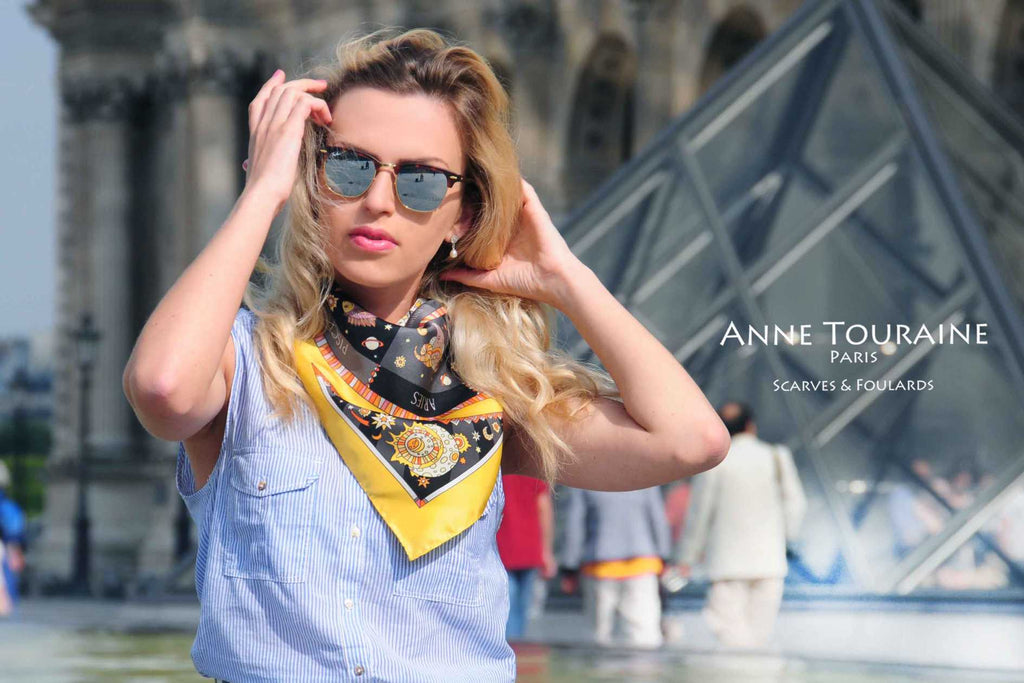 French silk scarves, Astrology and Zodiac design in yellow and black color, by ANNE TOURAINE Paris™, tied as a neck bandana