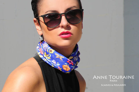 Floral blue silk scarf by ANNE TOURAINE Paris™ criss crossed to create a fluffy neck scarf