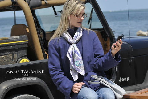 French silk scarf, Paris theme, blue color, by ANNE TOURAINE Paris™ tied around the neck in a casual way