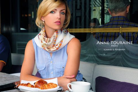 French silk scarf, astrology zodiac theme, white color, by ANNE TOURAINE Paris™ tied in a casual way around the neck