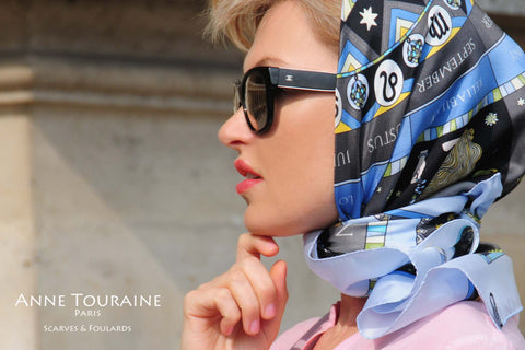 French silk scarf, astrology and zodiac theme, blue color, by ANNE TOURAINE Paris™ tied a la Grace Kelly