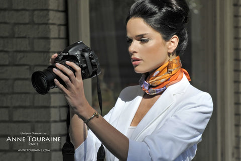 French silk scarf, Silk Road theme, orange color, by ANNE TOURAINE Paris™ tied around the neck