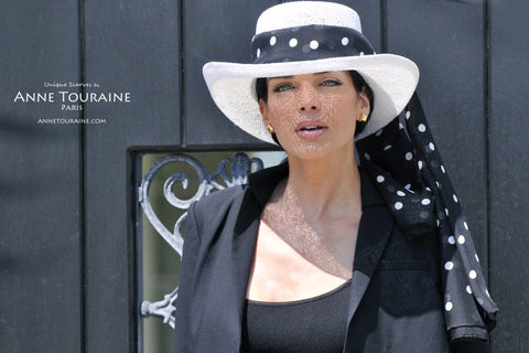 ANNE TOURAINE Paris™ silk scarves: polka dot collection; black color; tied around a straw hat