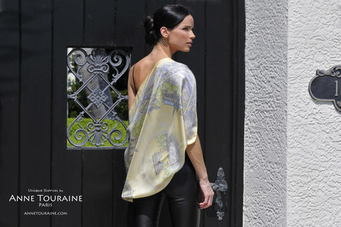 ANNE TOURAINE Paris™ French silk scarves: Paris inspired design; yellow color; tied as a stunning shoulder wrap