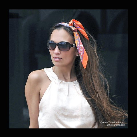 Orange scarf by ANNE TOURAINE Paris™ tied as a headband