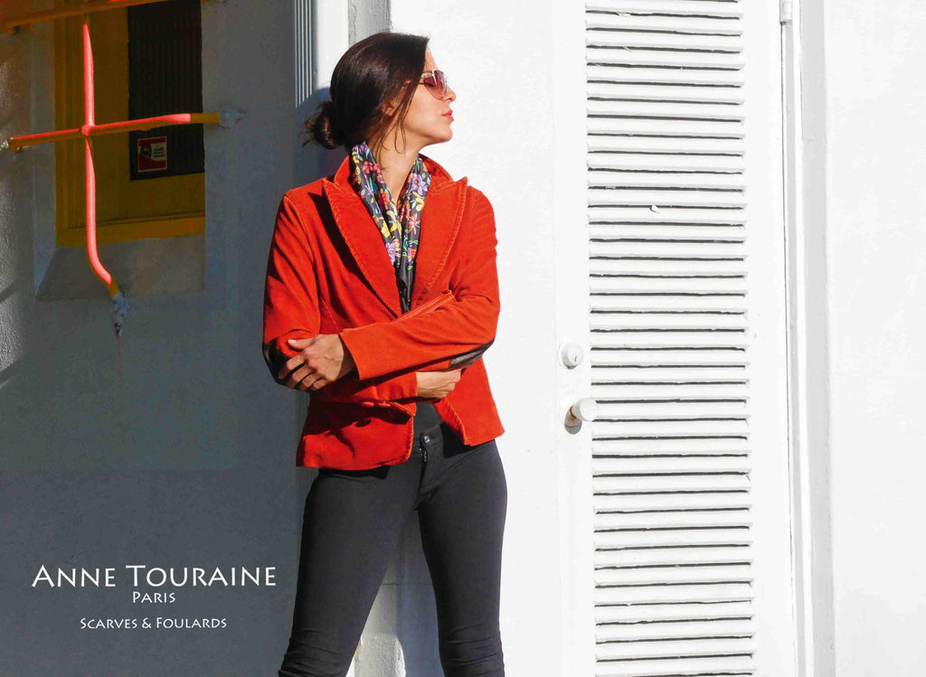 French silk scarves by ANNE TOURAINE Paris™: Floral grey scarf tucked in under a jacket