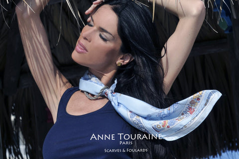Blue nautical silk scarf by ANNE TOURAINE Paris™ tied in a romantic way