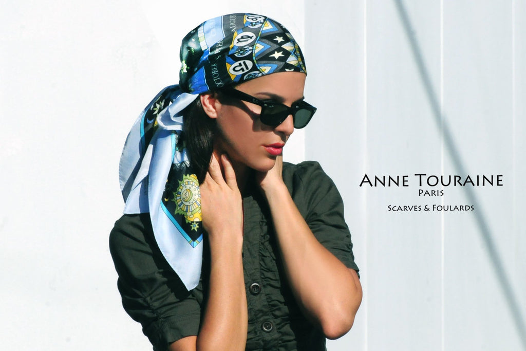 French silk scarves by ANNE TOURAINE Paris™: Zodiac astrology blue scarf tied over the hair pirate way