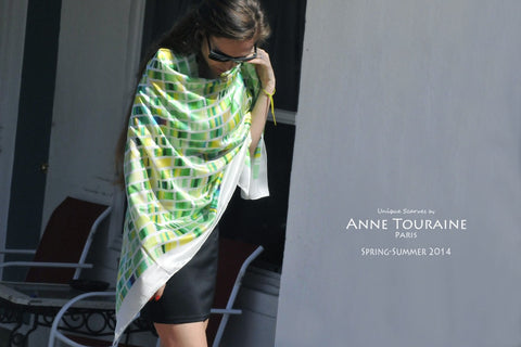 green and white extra large silk scarf by ANNE TOURAINE Paris™ tied as a wrap over a little black dress.