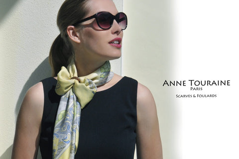 Yellow silk scarves by ANNE TOURAINE Paris™ with a scarf ring. Butterfly knot