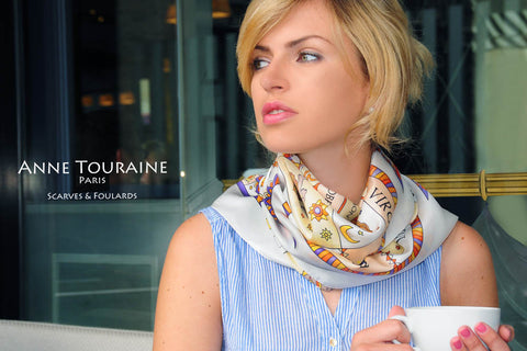 Zodiac inspired scarves: white ASTROLOGICAL silk scarf by ANNE TOURAINE Paris™ worn loose around the neck