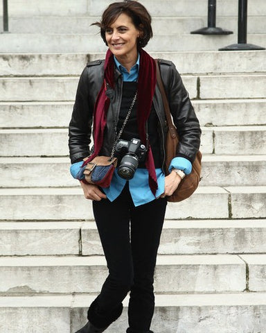 Ines de la Fessange stylish with a pair of jeans and a scarf