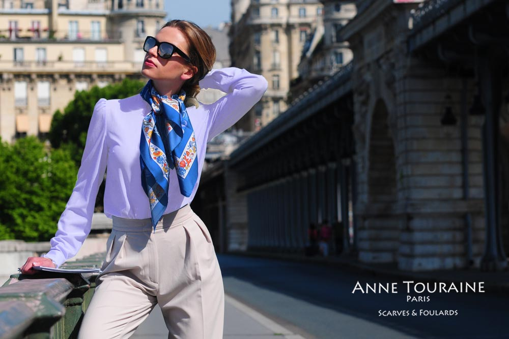 Luxurious French silk scarves by ANNE TOURAINE Paris™: Nautical blue scarf tied casually around the neck