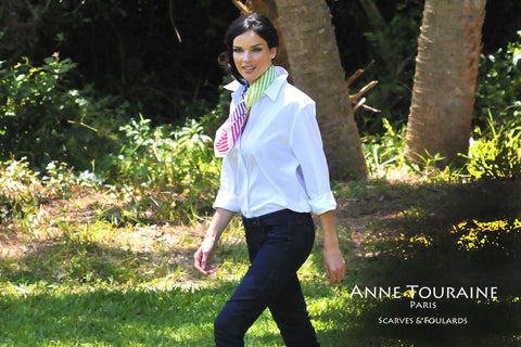 Striped multicolor silk scarf on a white blouse over a pair of jeans. Scarf ANNE TOURAINE Paris™