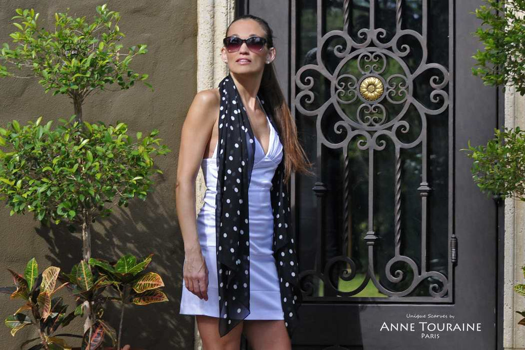 Chiffon silk scarves by ANNE TOURAINE Paris™: black polka dot scarf hanging loose and casual around the neck