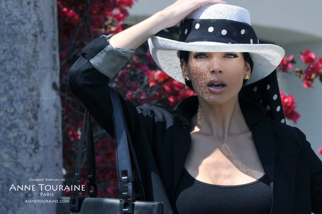 Chiffon silk scarves by ANNE TOURAINE Paris™: black polka dot scarf tied around a white panama hat