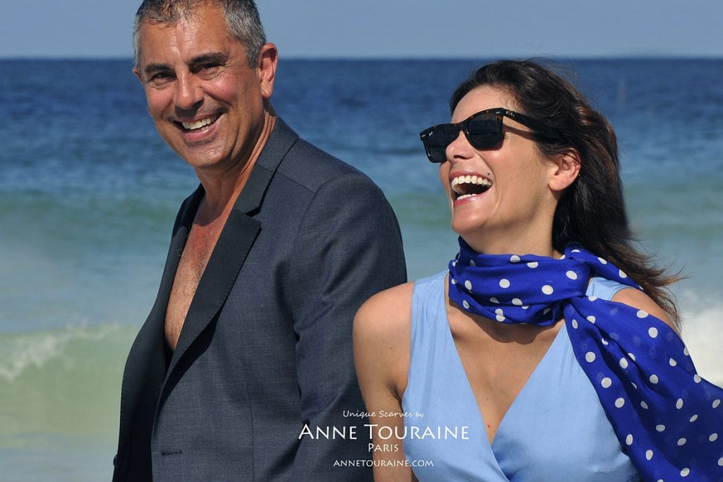 Chiffon silk scarves by ANNE TOURAINE Paris™: blue polka dot scarf loose tied at the side of the neck