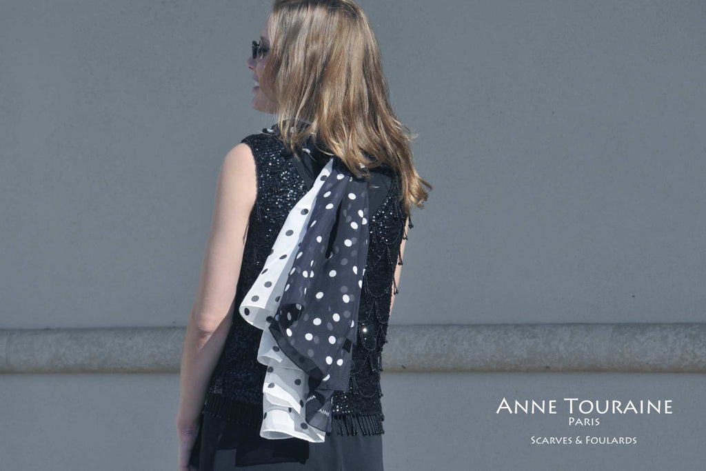 Chiffon silk scarves by ANNE TOURAINE Paris™: black polka dot scarf and white polka dot scarf tied together at the back