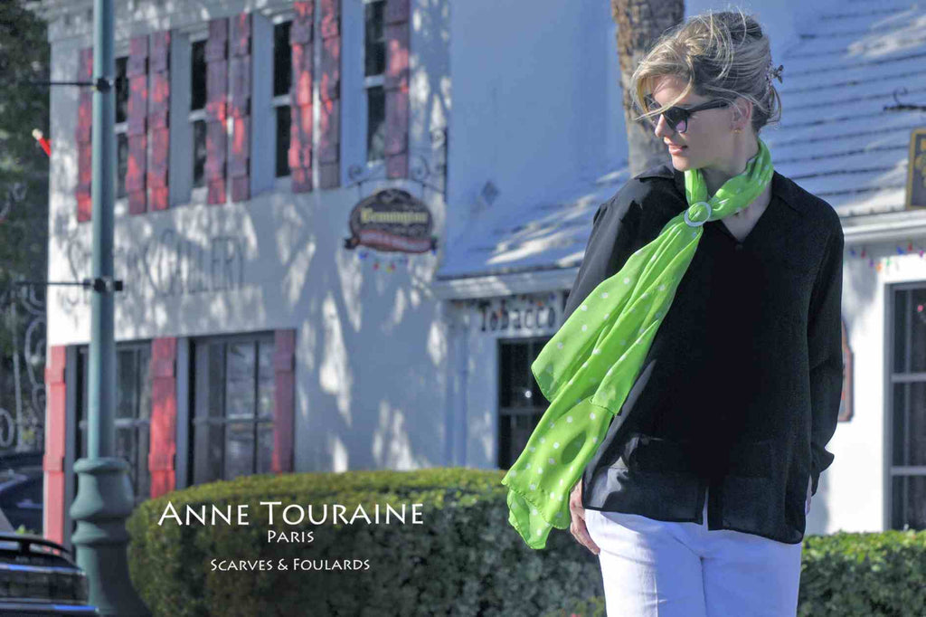 Chiffon silk scarves by ANNE TOURAINE Paris™: green polka dot scarf tied to the front with a white mother of pearl scarf ring