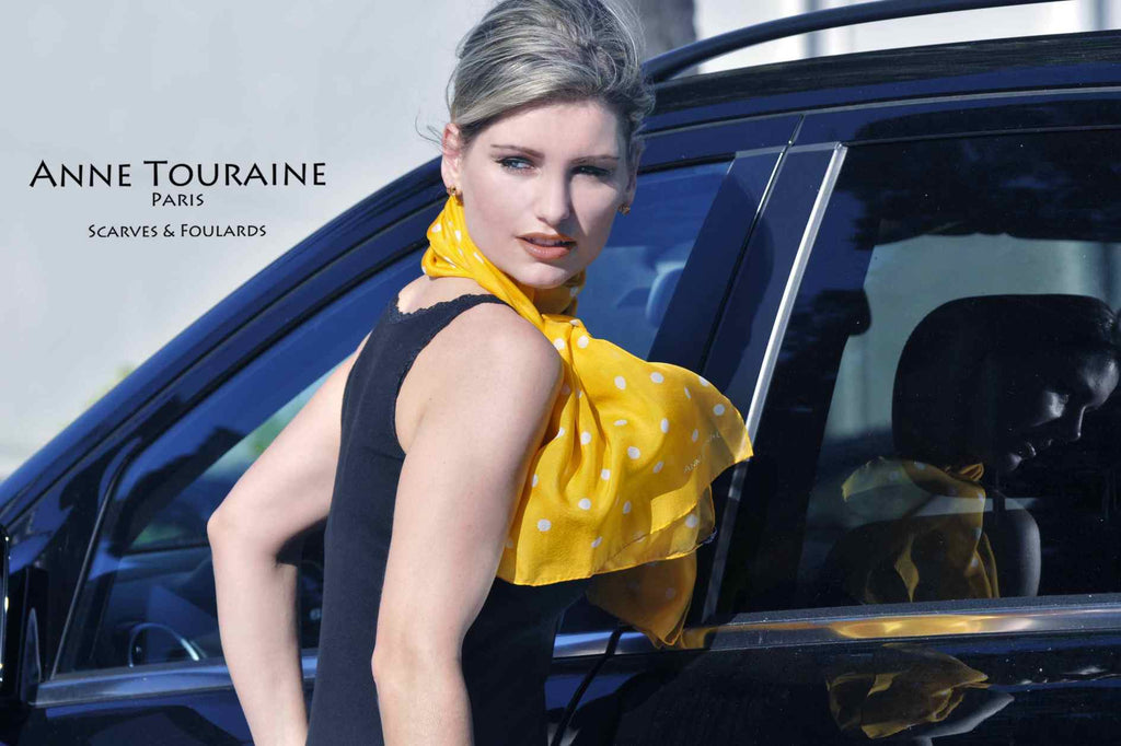 Chiffon silk scarves by ANNE TOURAINE Paris™: orange polka dot scarf wrapped twice around the neck and tied to the front