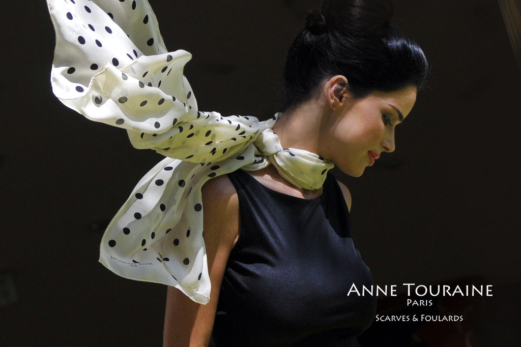 Chiffon silk scarves by ANNE TOURAINE Paris™: champagne polka dot scarf tied on the side of the neck and flowing in the wind