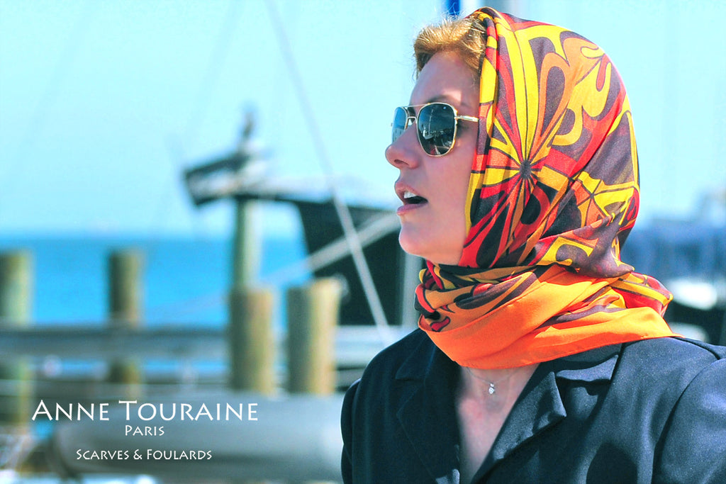 Extra large silk chiffon scarf multicolor around a ponytail Extra large silk chiffon scarves by ANNE TOURAINE Paris™: orange and black scarf as a head scarf a la Grace Kelly