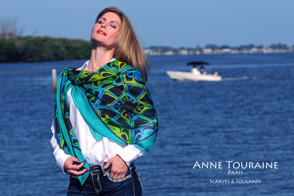 Extra large silk chiffon scarf multicolor around a ponytail Extra large silk chiffon scarves by ANNE TOURAINE Paris™: teal and black scarf as a shoulder wrap