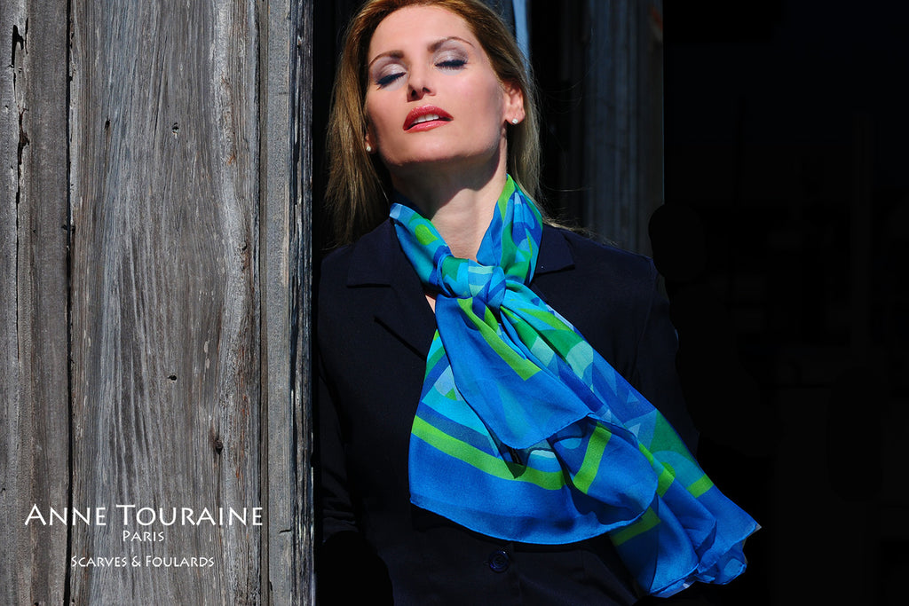 Extra large silk chiffon scarf multicolor around a ponytail Extra large silk chiffon scarves by ANNE TOURAINE Paris™: green and blue scarf tied to the front with one simple knot