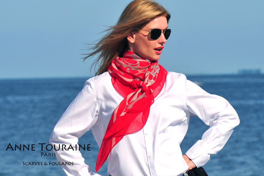 Extra large silk chiffon scarves: red scarf tied at the front of the neck