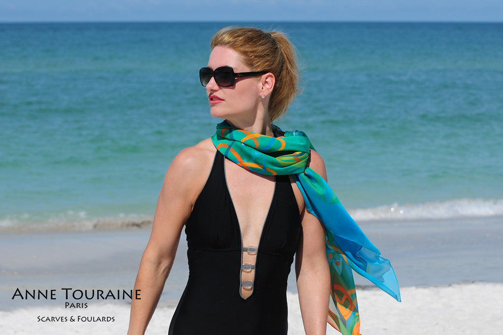 Extra large silk chiffon scarves: teal and orange scarf around the neck and tilted to the side
