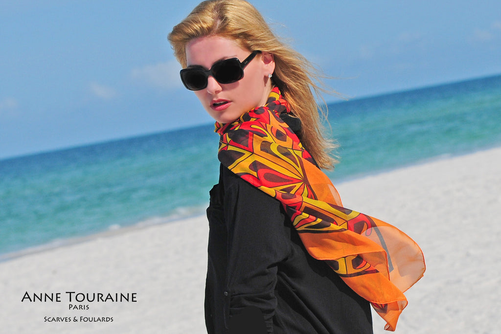 Extra large silk chiffon scarves: orange and black scarf around the neck and tilted to the side
