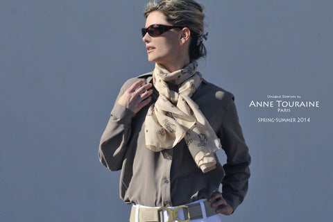 Beige chiffon silk scarf by ANNE TOURAINE Paris™ with dog pattern tied loose around the neck