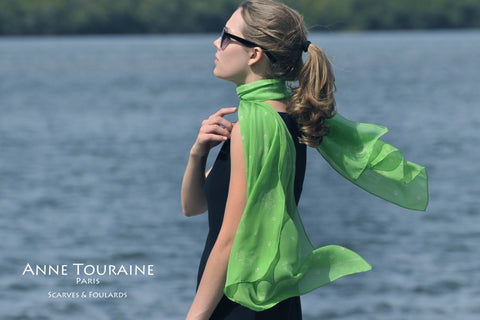 Green scarf by ANNE TOURAINE Paris™ with dog pattern, green color, tied in a romantic style